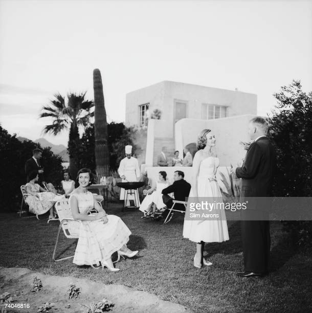 A group of people attending a barbeque at the Camelback Inn Scottsdale Arizona 1957