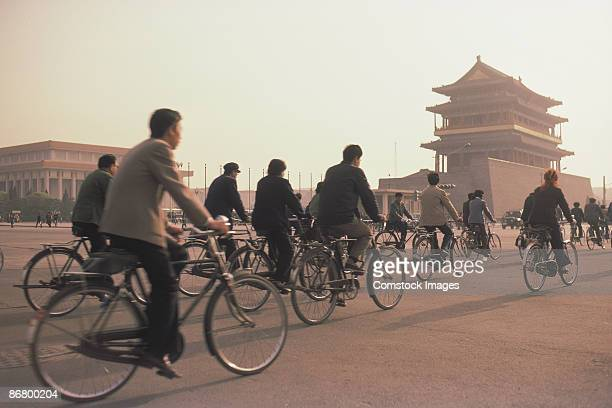Group of people bicycling in Tiananmen Square.