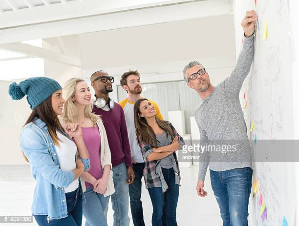 Group of people brainstorming at a creative office