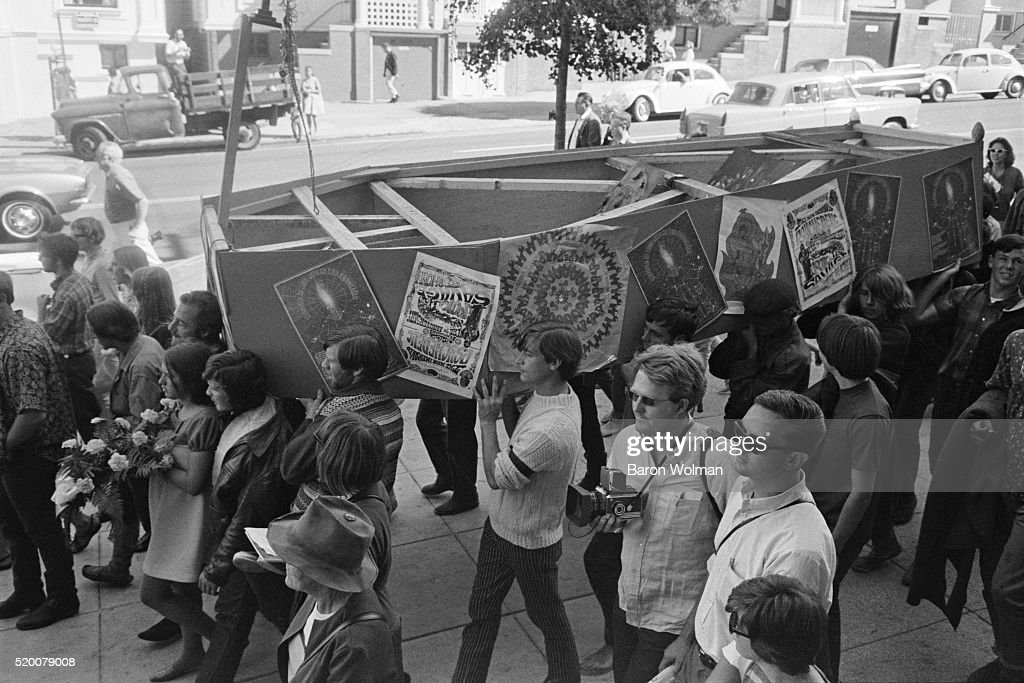 A group of people carry a fake coffin during the ceremony of 'The Death of the Hippie', a mock funeral organised by Mary Kasper to signal the conclusion of the scene in the Haight Ashbury District of San Francisco, CA, on October 6, 1967.