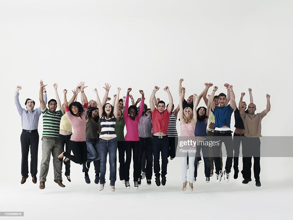 Group of people celebrating and jumping in the air : Stock Photo
