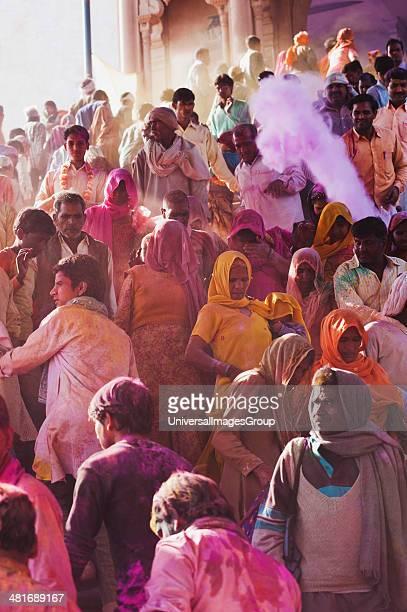 Group of people celebrating Holi festival Barsana Uttar Pradesh India