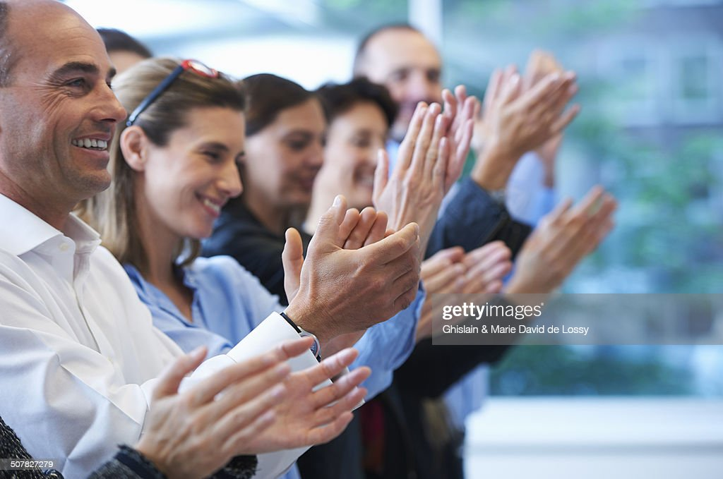 Group of people clapping : Stock Photo