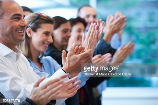 Group of people clapping