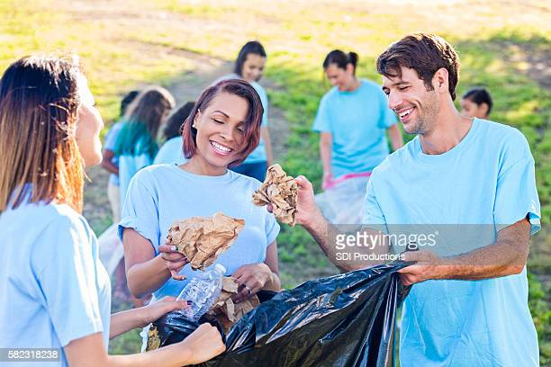 Group of people cleaning up their park