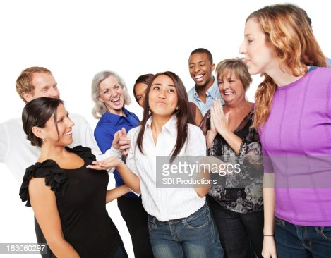 Group of People Congratulating a Friend