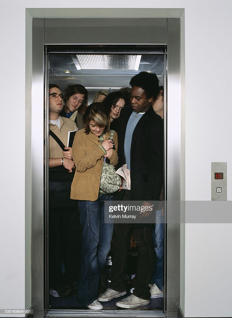 Group of people crammed into lift