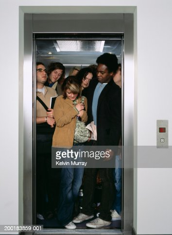Group of people crammed into lift : Stock Photo