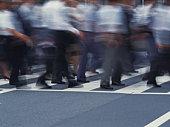 Group of people crossing at crosswalk