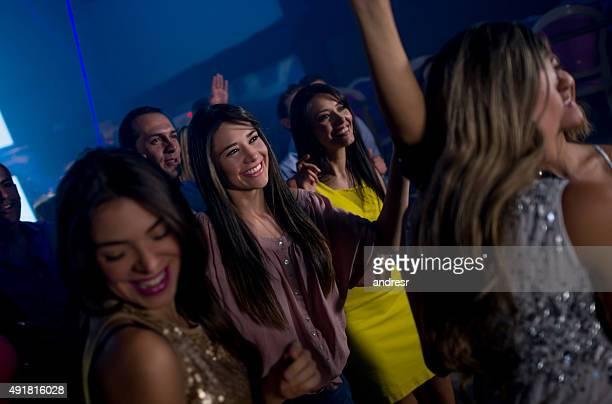 Group of people dancing at a nightclub