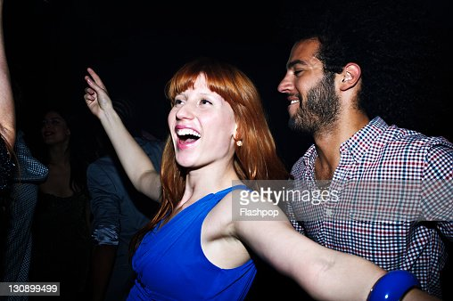 Group of people dancing at nightclub : Stock Photo