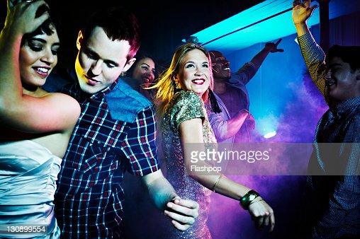 Group of people dancing at nightclub : Foto de stock