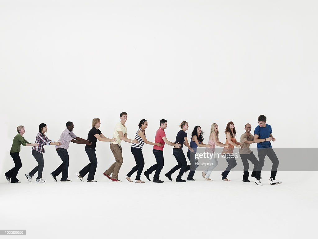 Group of people dancing in a line