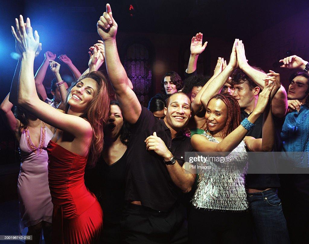 Group of people dancing in nightclub : Stock Photo
