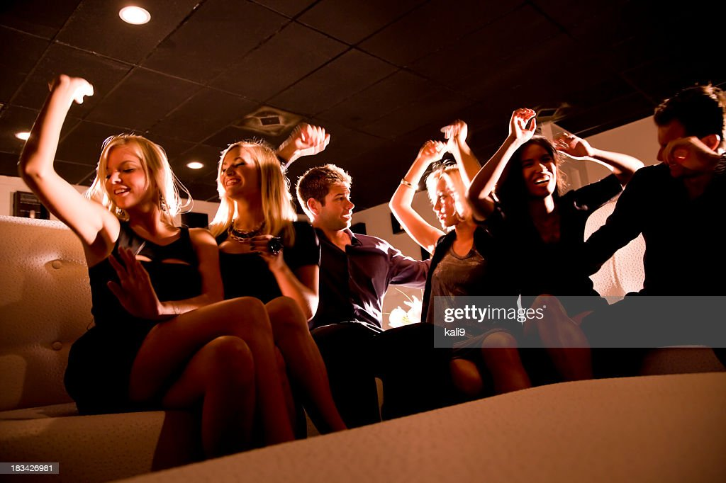 Group of people dancing on couch in nightclub : Stock Photo