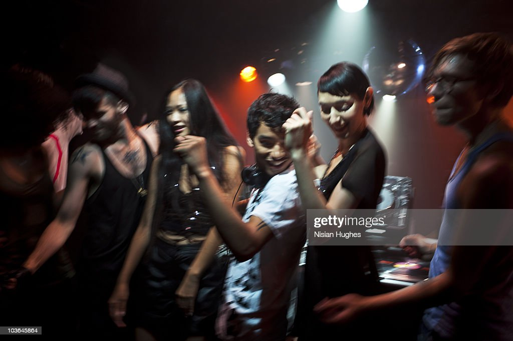 group of people dancing with DJ : Stock Photo