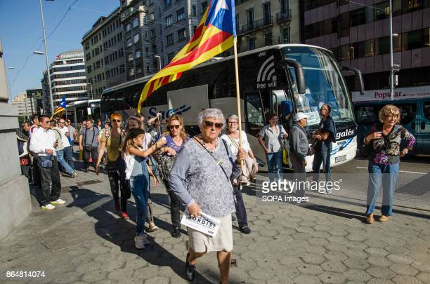 A group of people descended from the coaches that have come to Barcelona to join the rally About 450000 people have been focused to support the...