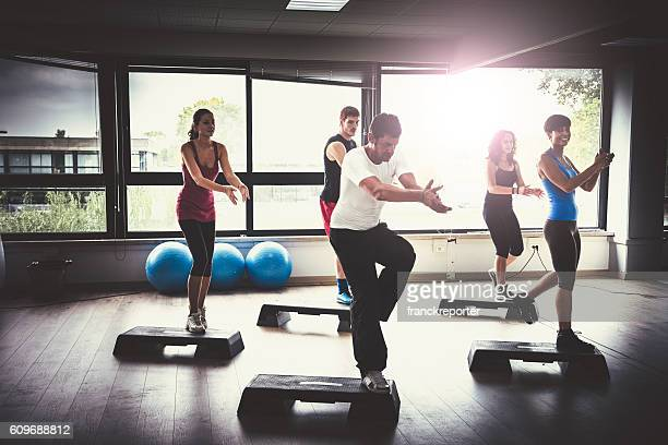 Group of people doing aerobics in the gym