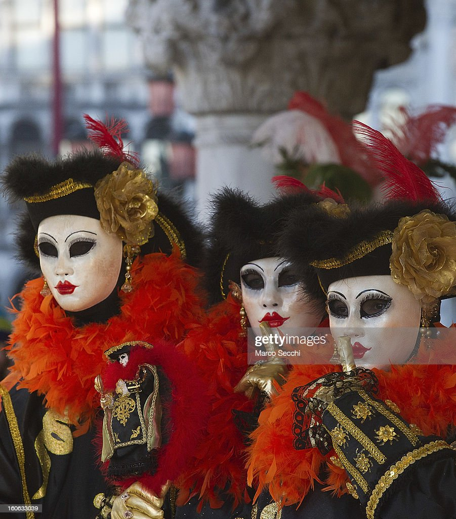 A group of people dressed in costume poses in Saint Mark's Square during the Venice Carnival 2013 on February 4, 2013 in Venice, Italy. The 2013 Carnival of Venice runs from January 26 - February 12 and includes a program of gala dinners, parades, dances, masked balls and music events.