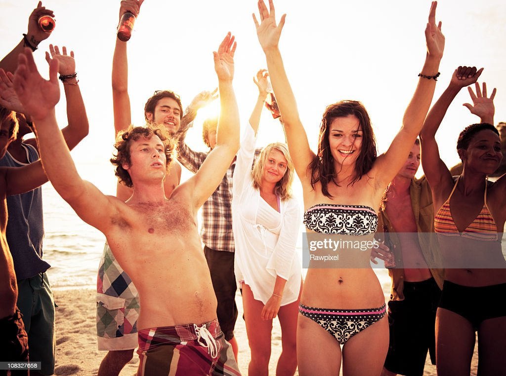 Group of People enjoying a Summer Beach Party : Stock Photo