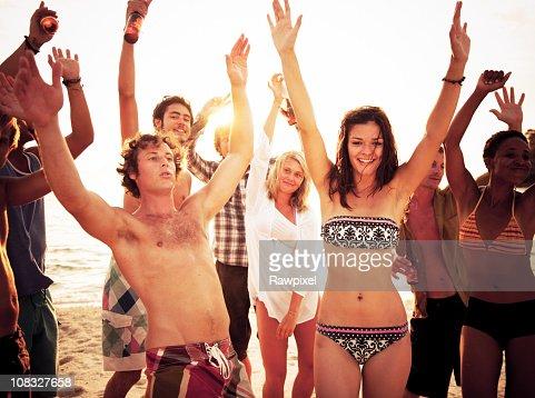 Group of People enjoying a Summer Beach Party : Bildbanksbilder