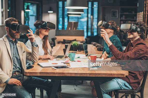 Group of people enjoying virtual reality technology