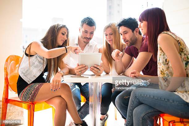 Group of people enjoying with a tablet