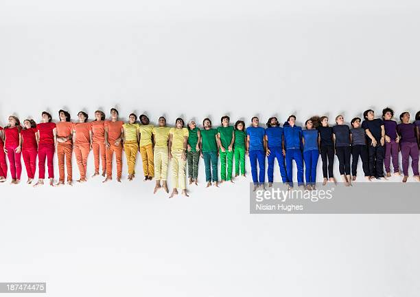 Group of People Forming a Rainbow on Studio Floor