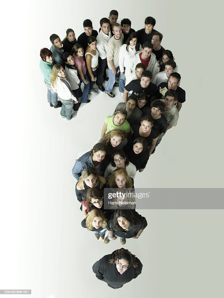 Group of people forming question mark, overhead view : Stock Photo