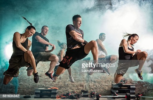 group of people full of energy doing kick exercise : Stock Photo