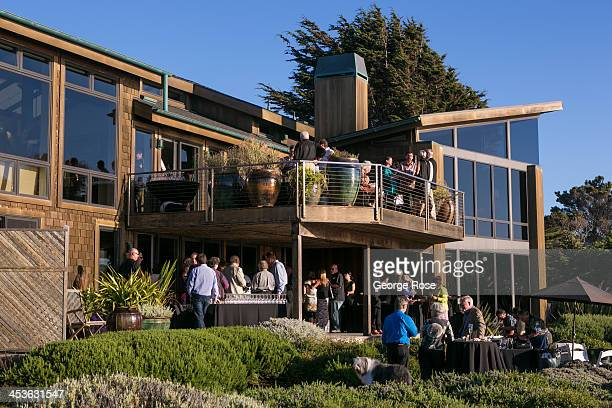 A group of people gather for a party at a home overlooking the Pacific Ocean near the Mendocino Coast Botanical Gardens on September 6 in Fort Bragg...