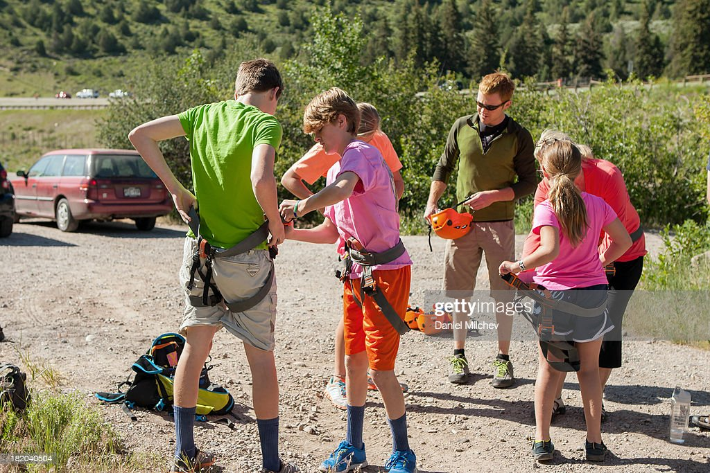 Group of people getting ready to rock climb. : Stock Photo