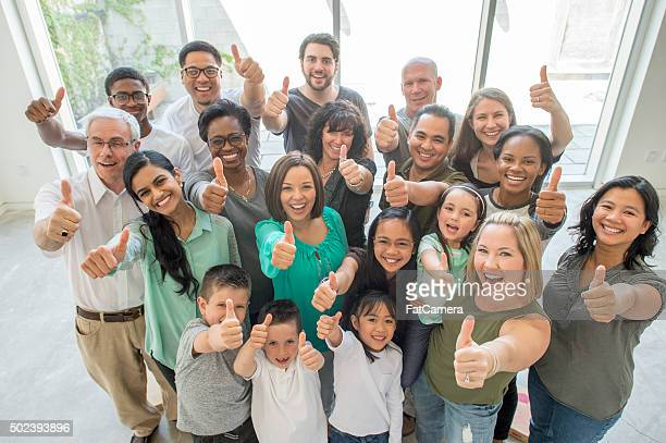 Group of People Giving a Thumbs Up