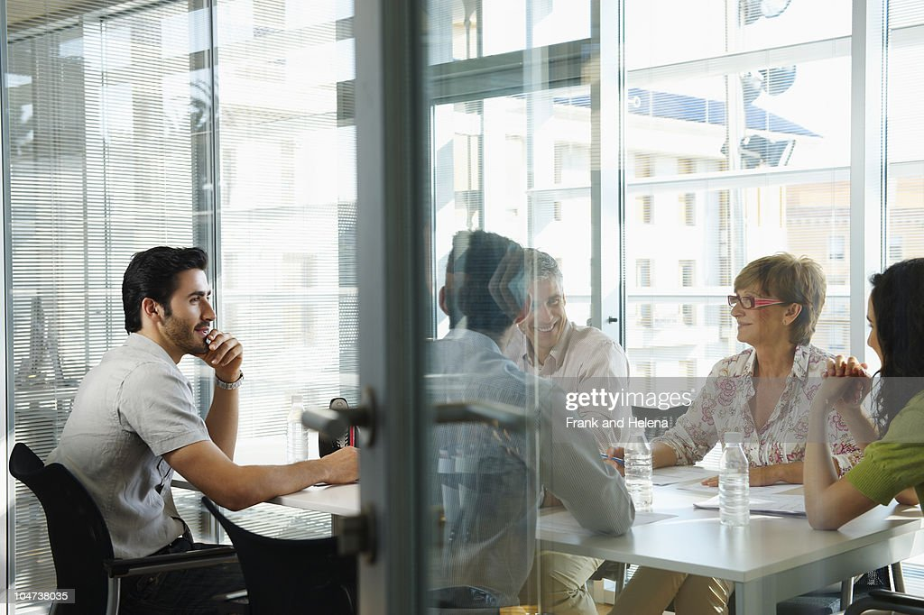 Group of people having a casual meeting : Stock Photo