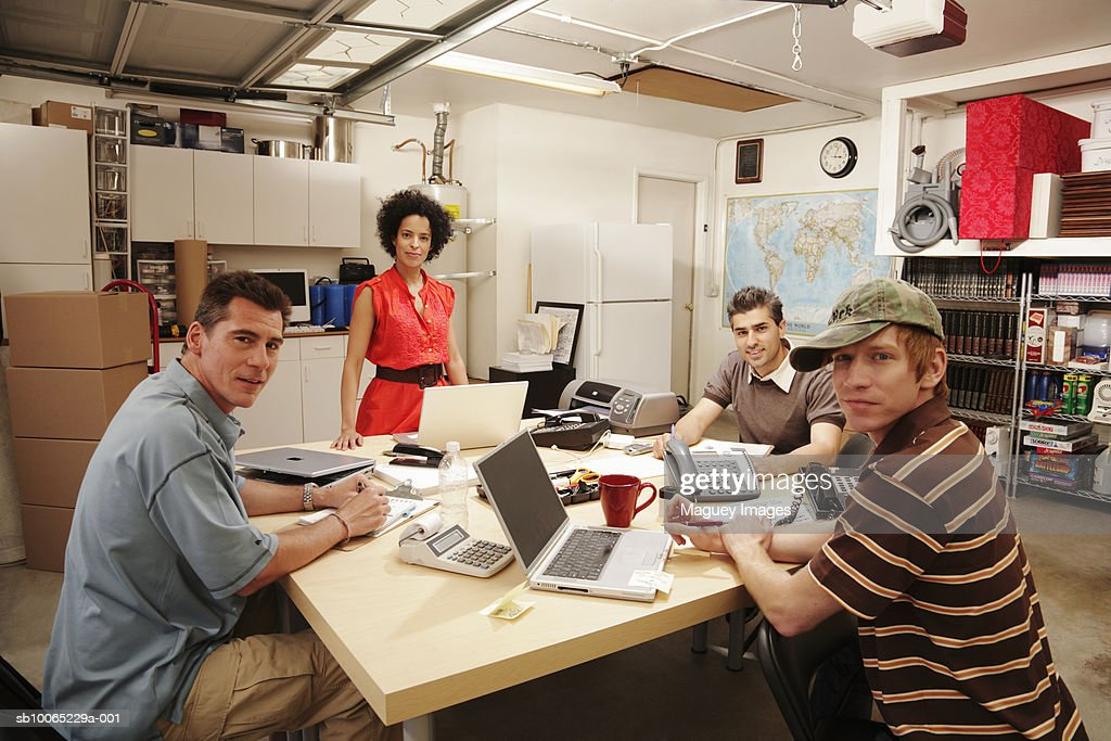 Group of people having business meeting in garage : Stock Photo