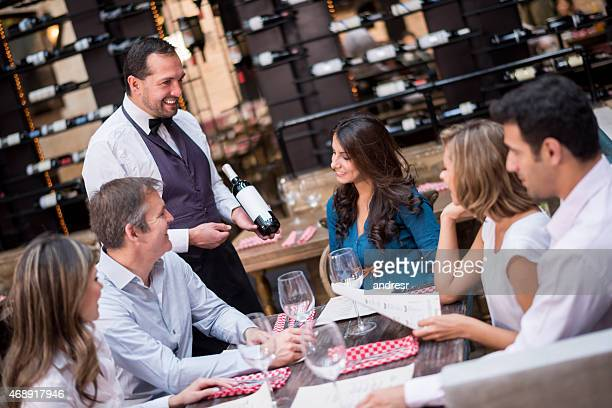 Group of people having dinner and drinking wine