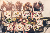 Group of people having meal togetherness dining