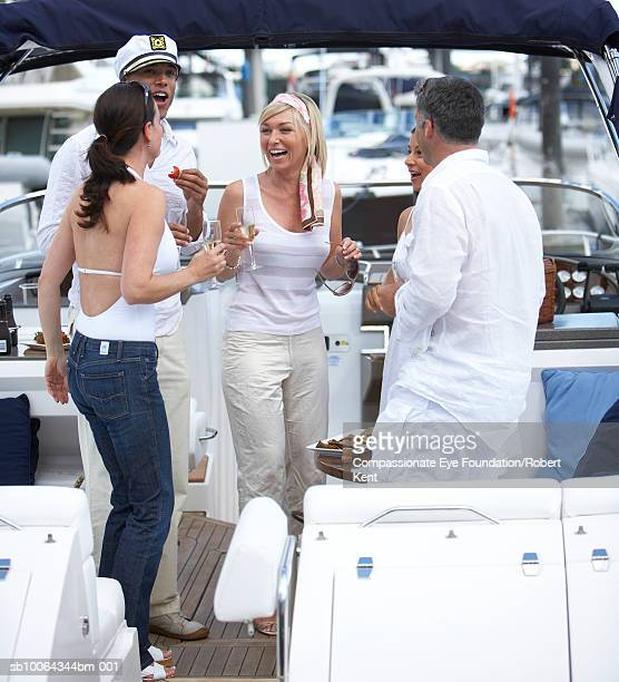 Group of people having party on yacht