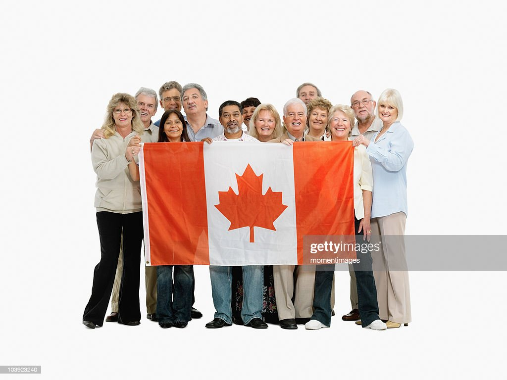 group of people holding a canadian flag stock photo getty images
