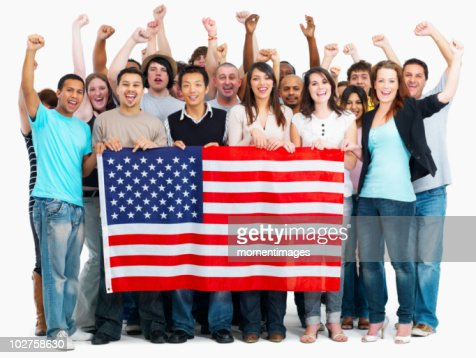 Group of people holding American flag : Stock Photo