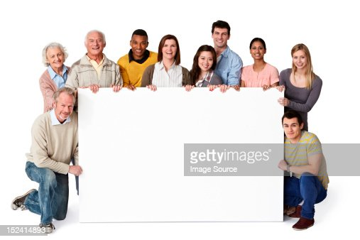 Group of people holding blank notice board : Stock Photo