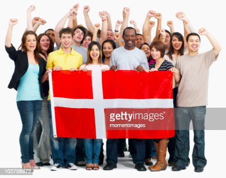 Group of people holding flag : Stock Photo