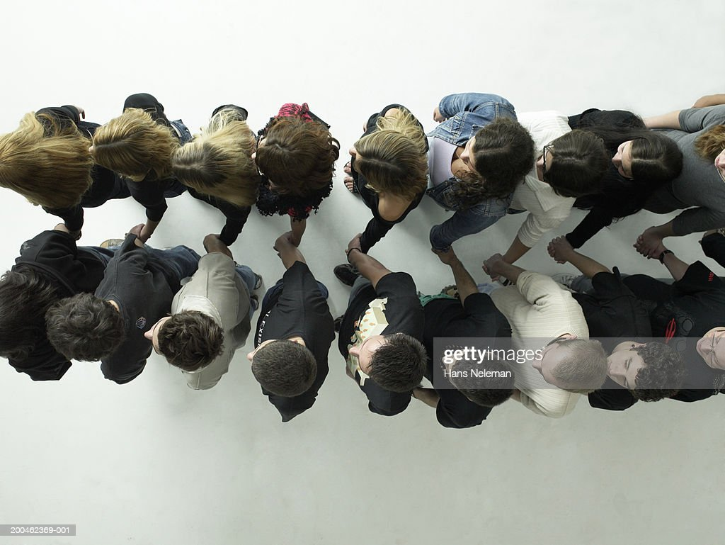 Group of people holding hands, view from above : Stock Photo
