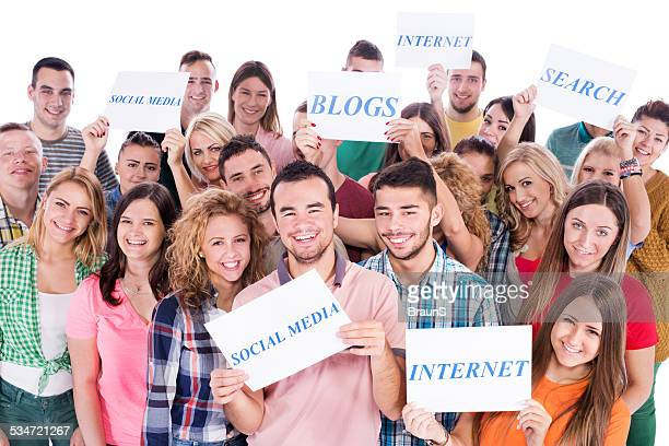 Group of people holding social network sings.