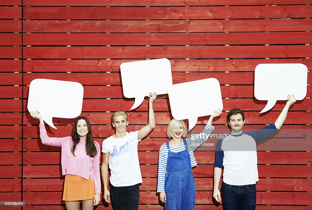 group of people holding up speech bubbles