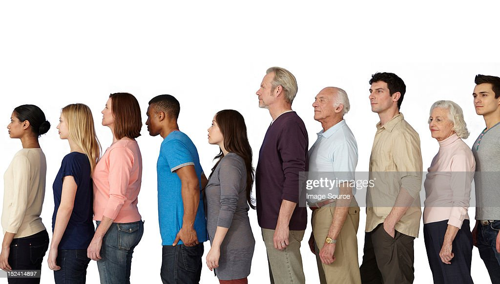 Group of people in a line, side view