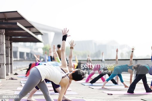 Group Of People In An Outdoor Yoga Class