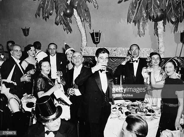 A group of people in formal attire celebrate on New Years Eve at the El Morroco night club in New York City circa 1935