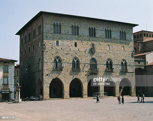 Group of people in front of a building Town Hall Pistoia Tuscany Italy