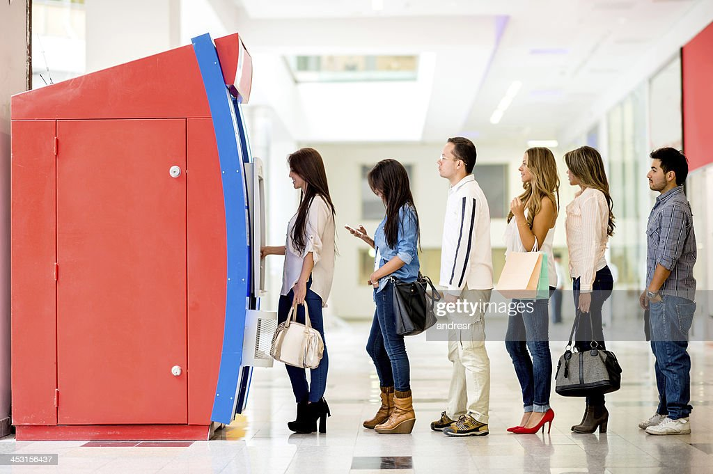 Group of people in line for the ATM